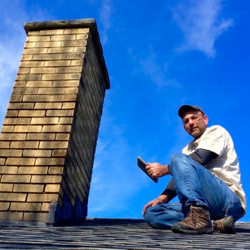 John Lawson of Assured Home Inspections inspecting the roof of a single-family home in Northern Kentucky