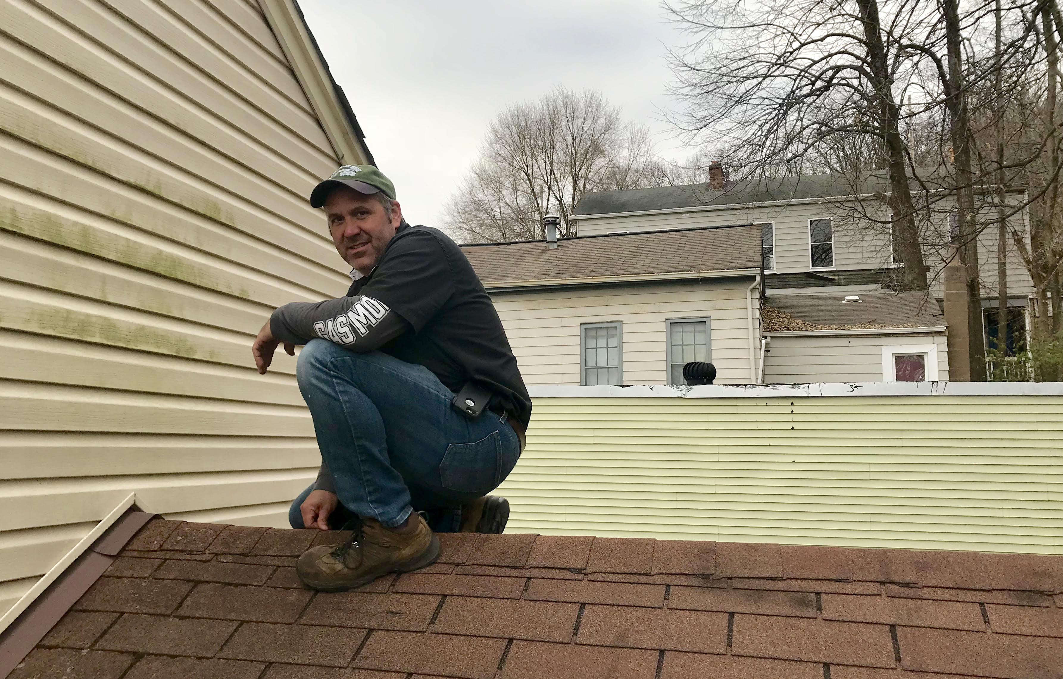 Wayne Mitchell of Assured Home Inspections inspecting the roof of a single family home